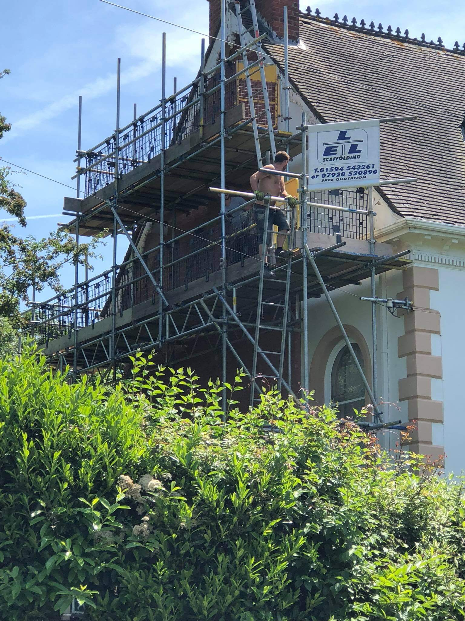 Painting and render scaffolding on a church