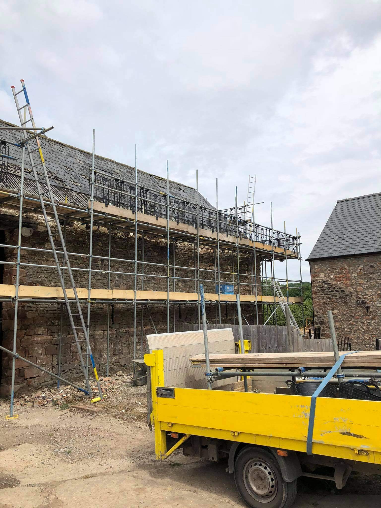 Two tier scaffolding for a farmhouse